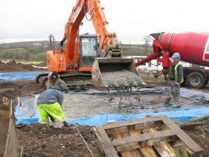 Concrete transferred by digger