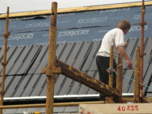 First, attach the plastic undersheeting to make the roof weather proof.
