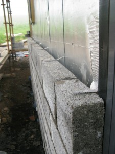 Wall ties every 600 millimetres, in every other course of blocks