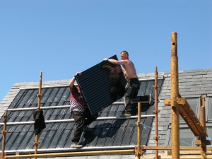 Then manhandle the suprisingly light panels onto the roof and clip them into position.
