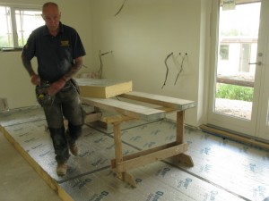 Pete getting stuck into laying the floor insulation boards